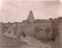 General view from north-east looking towards the main tower of the Brihadishvara Temple, with the fort wall and moat in the foreground, Thanjavur